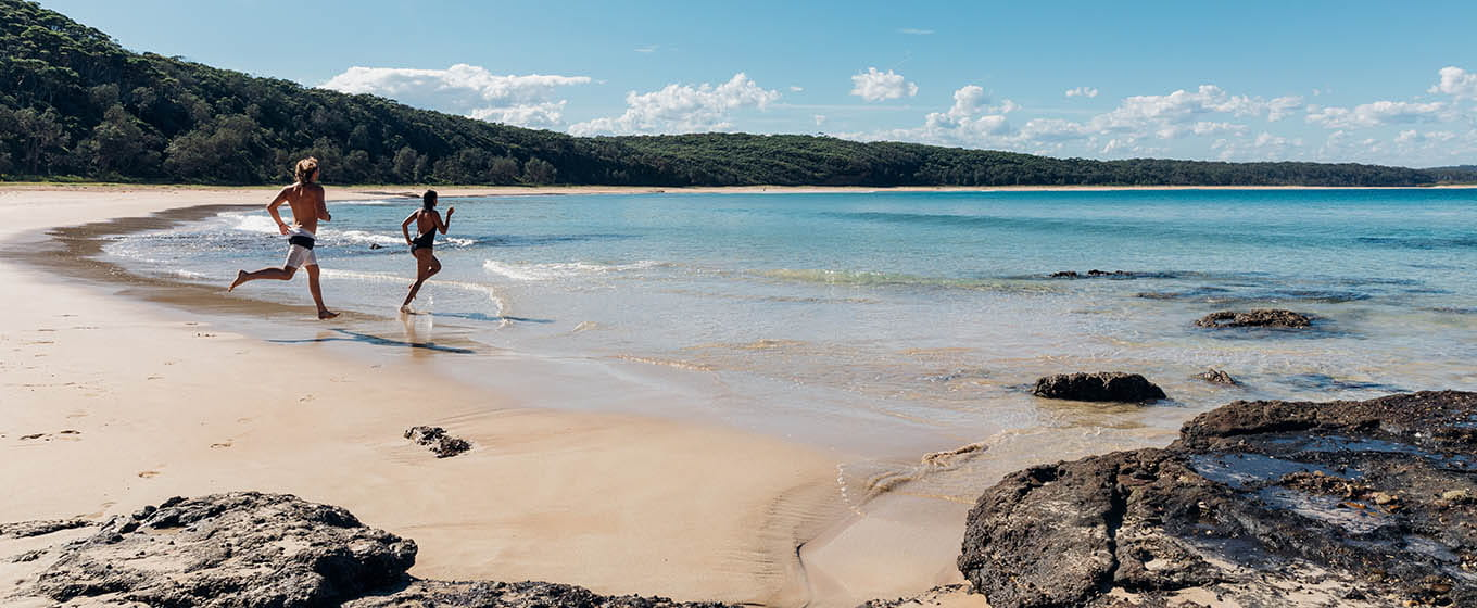 People running on beach in Murramarang National Park. Photo: Melissa Findley