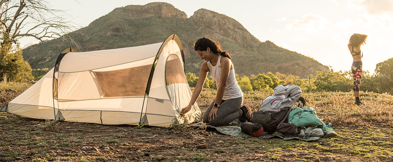 Women campers with a tent at Warrumbungle National Park. Photo: RObert Mulally/OEH.