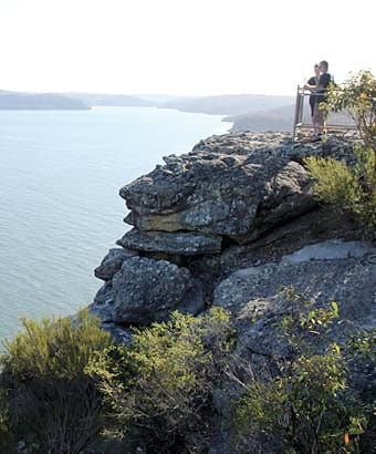 Two people admire views from Warrah lookout, Brisbane Water National Park. Photo: John Yurasek/OEH
