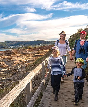 A family enjoy Boudi coastal walk in Bouddi National Park. Photo: John Spencer/OEH