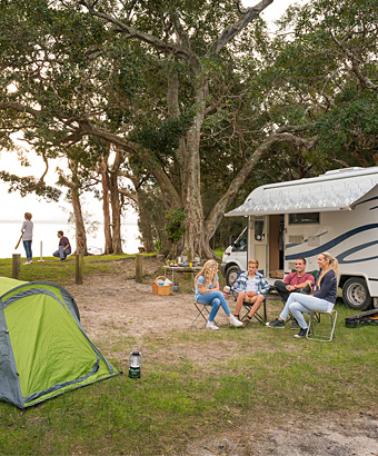 Campers sitting in front of their camper trailer at Mungo Brush campground.  Photo  John b9218a628