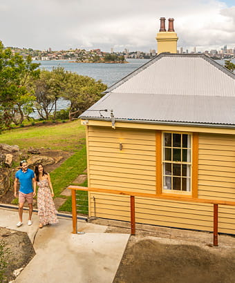 View of Steele Point Cottage with backdrop of Sydney Harbour and city skyline, Sydney Harbour National Park. Photo: John Spencer/OEH.