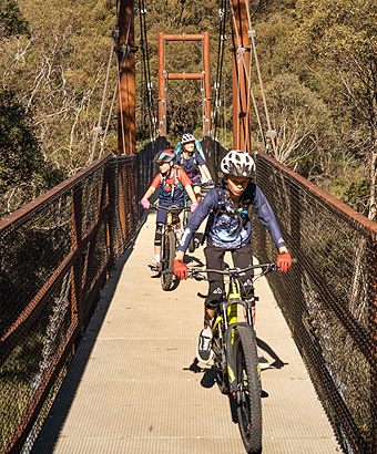Family riding the Thredbo Valley track in Kosciuszko National Park. Photo: Robert Mulally