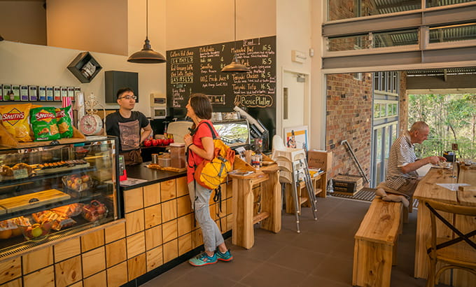 A woman orders a snack at the counter at Jenkins Hall Cafe, in Lane Cove National Park. Photo: John Spencer/OEH
