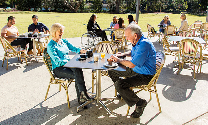 An older couple dine at Audley Cafe, Royal National Park. Photo: Simone Cottrell © DPIE
