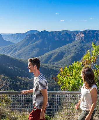 Bushwalkers take in lookout views at the start of Govetts Leap descent near Blackheath, in Blue Mountains National Park. Photo: Simone Cottrell/DPIE