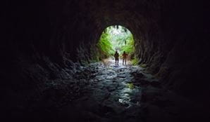 Two men at the opening of Glow Worm Tunnel, Wollemi National Park. Photo: Daniel Tran/OEH