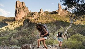 Two young women hiking in Warrumbungle National Park along Breadknife and Grand High Tops walk. Photo: Robert Mulally