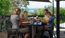 A family enjoying a meal at Trial Bay Kiosk Restaurant, Arakoon National Park. Photo: David Finnegan/NSW Government