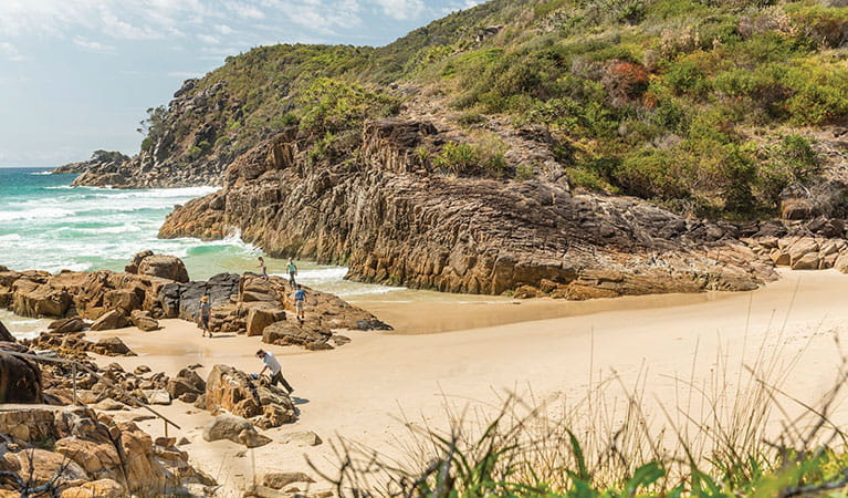 A family exploring the rocks at Little Bay beach in Arakoon National Park. Photo: David Finnegan/DPIE
