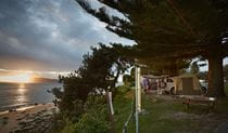 Beachside camping at Trial Bay Gaol campground, Arakoon National Park. Photo: Nick Cubbin/OEH