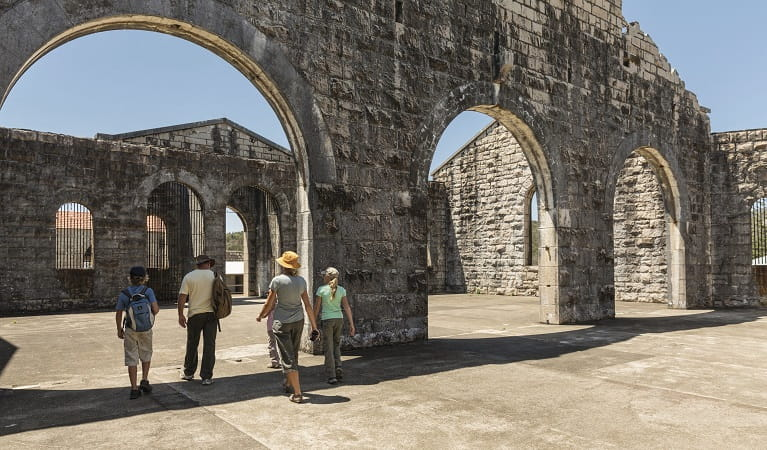 A family walking through an archway at Trial Bay Gaol in Arakoon National Park. Photo: David Finnegan/DPIE