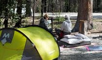 2 campers beside their tent at Bald Rock campground and picnic area in Bald Rock National Park. Photo: Leah Pippos © DPIE