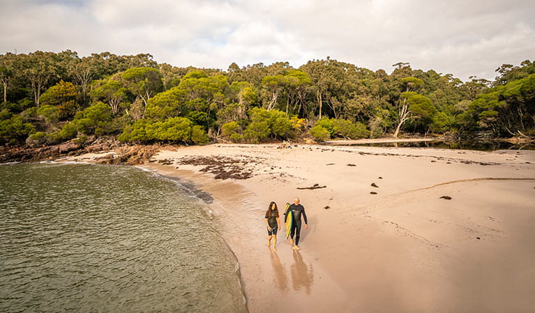 People walking along the sand at Bittangabee Bay. Photo: John Spencer/OEH