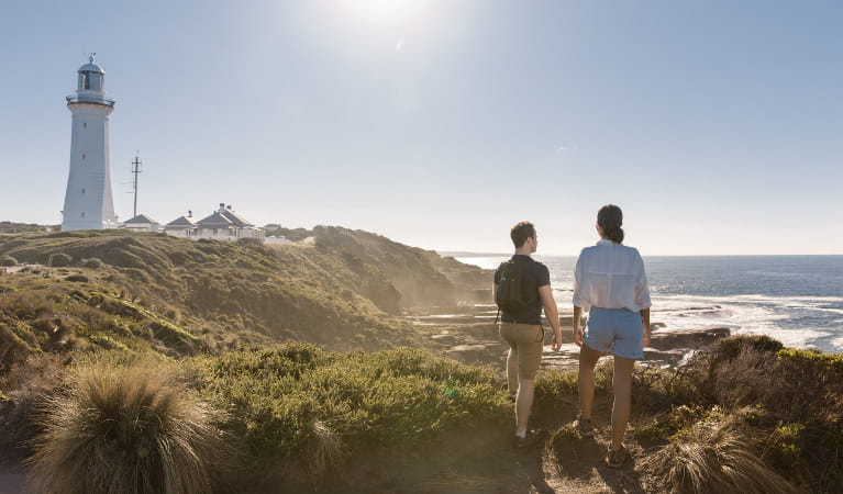 A couple takes in the coastal views of Green Cape Lightstation in Ben Boyd National Park. Photo: Tim Clark/DNSW