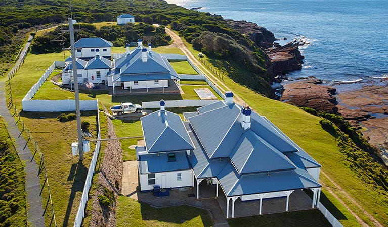 Aerial view of Green Cape Lightstation Keepers Cottages, next to the ocean. Photo: N Cubbin/DPIE