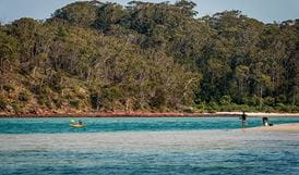 People kayaking and fishing at Severs Beach. Photo: John Spencer/DPIE