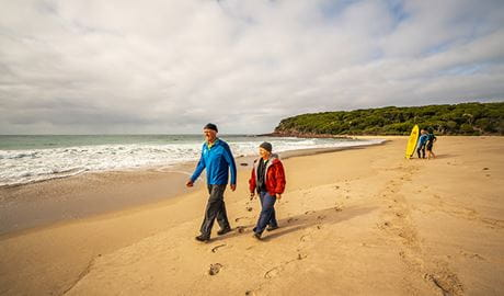 Bush walkers and surfers at Saltwater Creek campground, Ben Boyd National Park. Photo: J Spencer/OEH