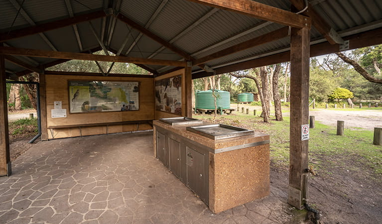 Barbecue facilities with shelter at Saltwater Creek campground, Ben Boyd National Park. Photo: J Spencer/OEH