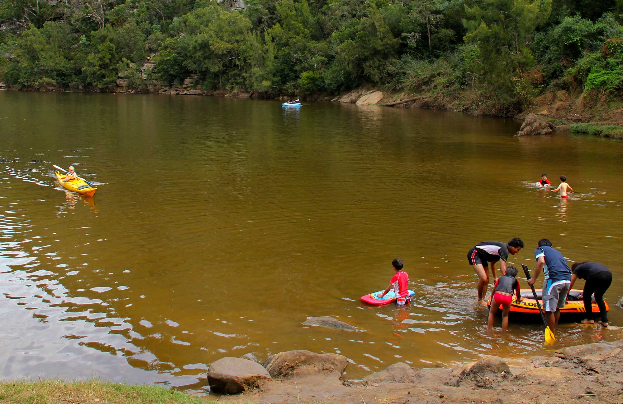 People swimming in the river. Photo:John Yurasek