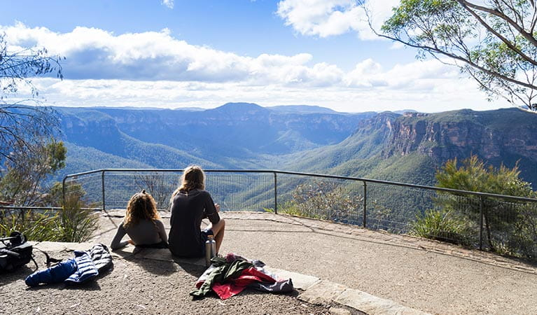 Hikers relax after a walk at Evans lookout, Blue Mountains National Park. Photo: Simone Cottrell/OEH.