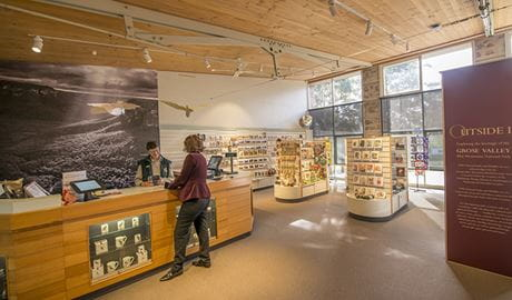 A visitor talks to staff at Blue Mountains Heritage Centre, Blue Mountains National Park. Photo: John Spencer/OEH.