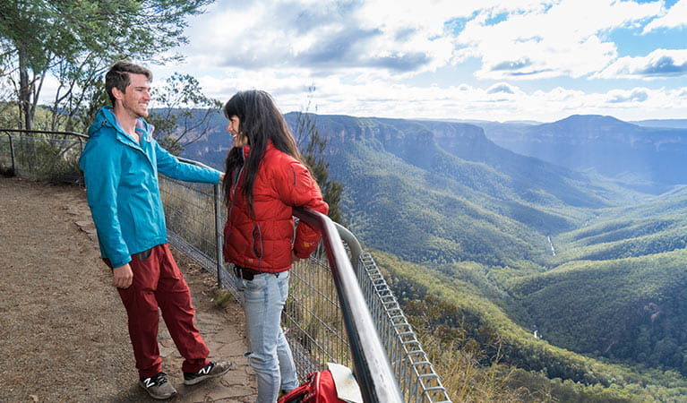 A couple at Evans lookout, Blue Mountains National Park. Photo: Simone Cottrell/OEH
