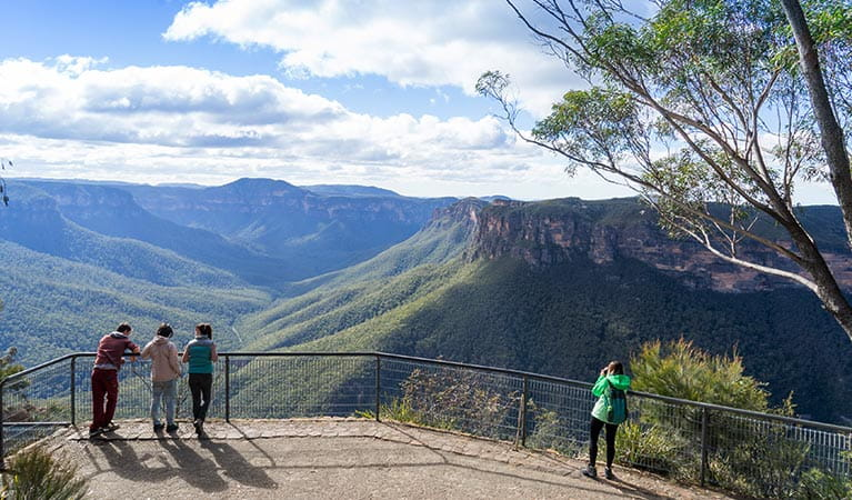 Visitors enjoy the views from Evans lookout, Blue Mountains National Park. Photo: Simone Cottrell/OEH.