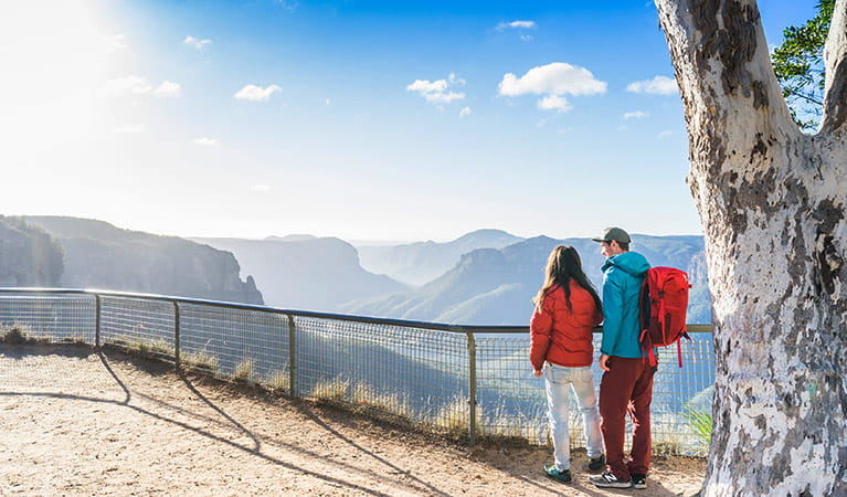 A couple at Govetts Leap lookout, Blue Mountains National Park. Photo: Simone Cottrell/OEH.