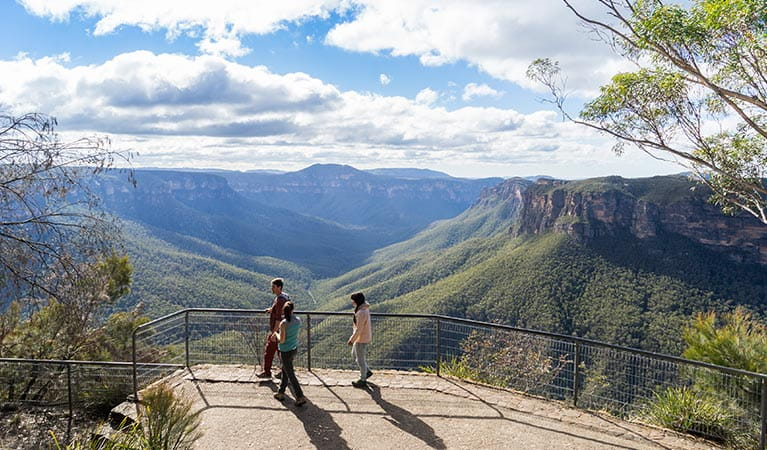 Visitors take in the views of Grose Valley from Evans lookout, Blue Mountains National Park. Photo: Simone Cottrell/OEH.