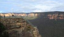 Three people at Pulpit Rock lookout's lower viewpoint, Blue Mountains National Park. Photo: E Sheargold/OEH.