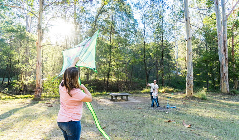 Family fly a kite in the Appletree Flat section of Euroka campground. Photo: OEH/Simone Cottrell