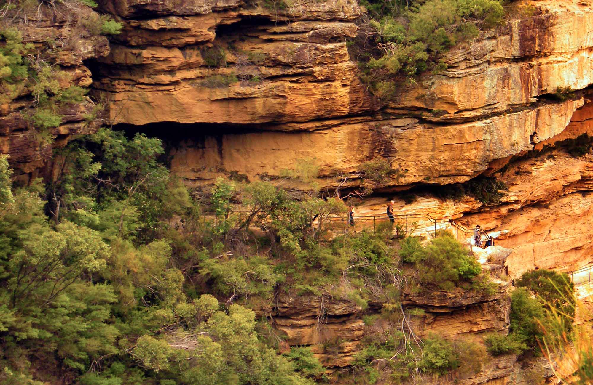 Hikers walk along cliff-edge National Pass, Blue Mountains National Park. Photo: Craig Marshall