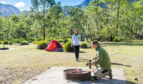 Campers use fire ring facilities at Kedumba River crossing campground, Blue Mountains National Park. Photo: Simone Cottrell/OEH.