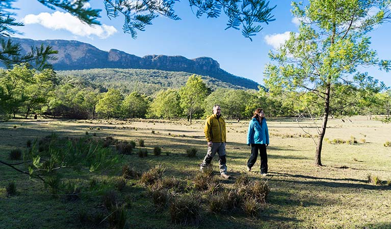 A couple bushwalk near Kedumba River Crossing campground, Blue Mountains National Park. Photo: Simone Cottrell/OEH