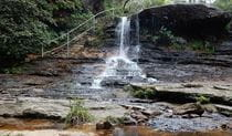 Water spills over Weeping Rock waterfall, near Wentworth Falls, in Blue Mountains National Park. Photo: Arthur Henry/OEH