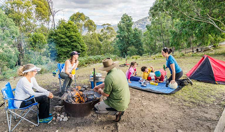 Children and adults gather beside a campfire at Dunphys campground, Blue Mountains National Park. Photo: Simone Cottrell/OEH.