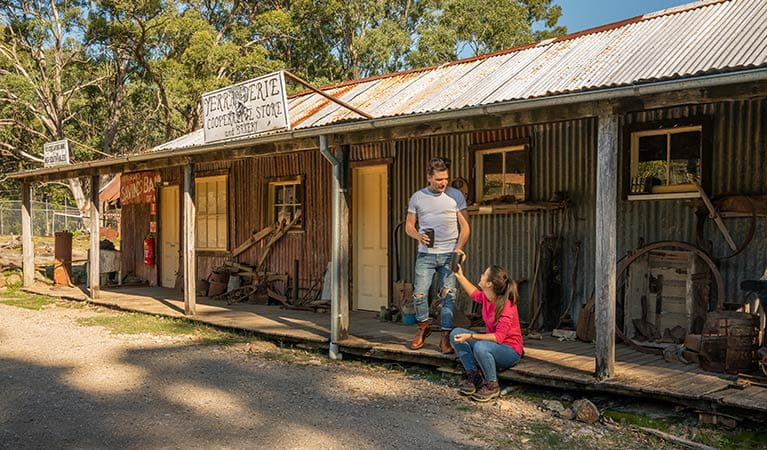 A couple drinking coffee on the verandah of The Bank Room in Yerranderie Private Town, Yerranderie Regional Park. Photo: John Spencer/OEH