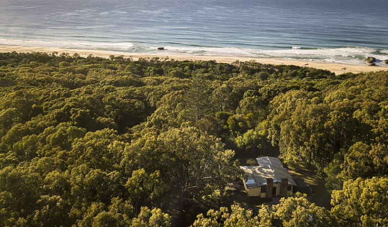Aerial view of Tuckers Rocks Cottage and bushland and beach surrounds. Photo: John Spencer/DPIE