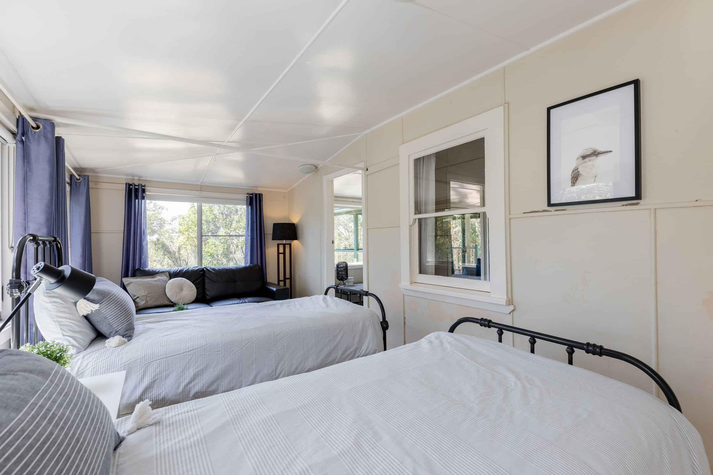 The second bedroom with single beds in Tuckers Rocks Cottage, Bongil Bongil National Park. Photo: Mitchell Franzi/DPIE