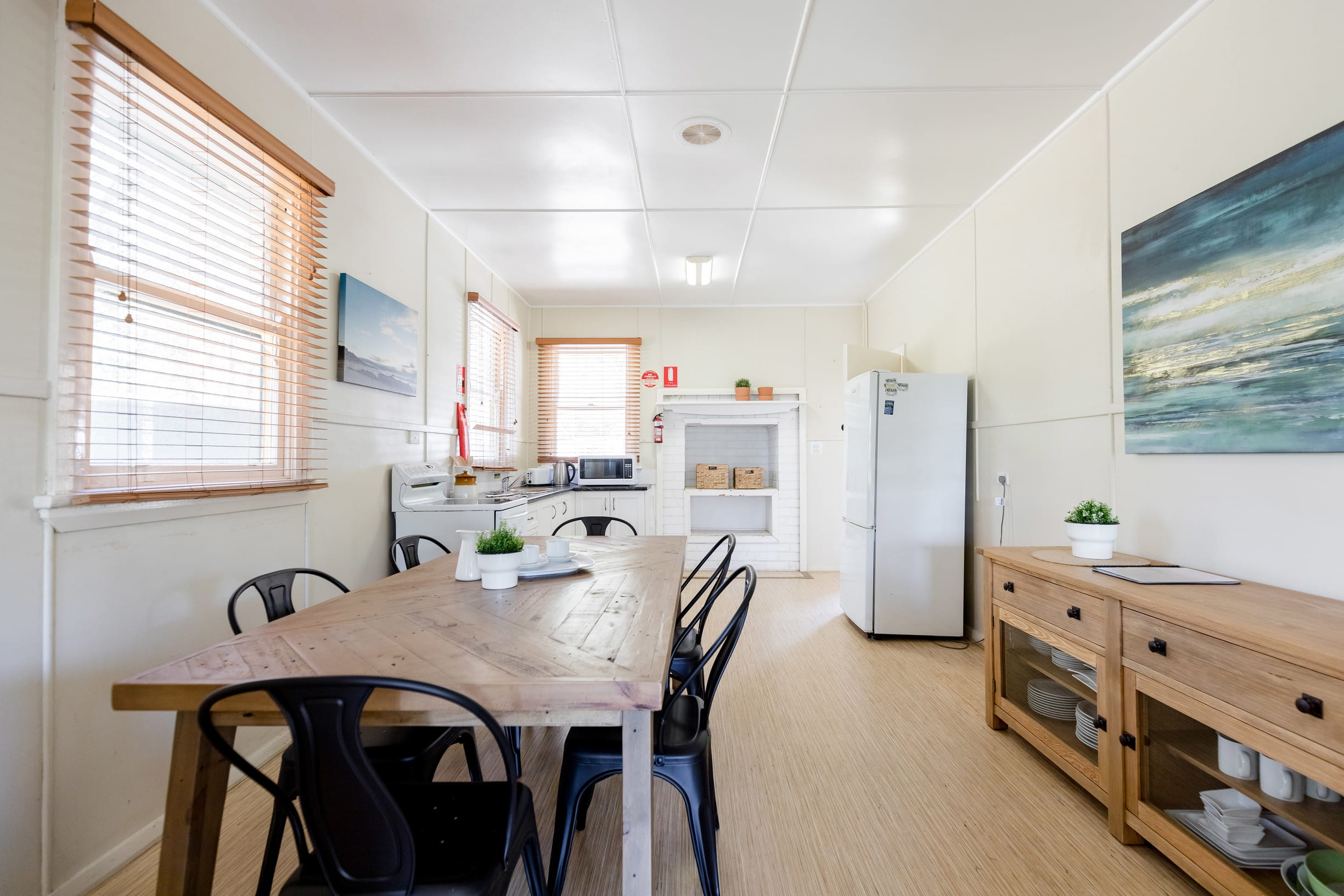 The kitchen and dining room at Tuckers Rocks Cottage in Bongil Bongil National Park. Photo: Mitchell Franzi/DPIE