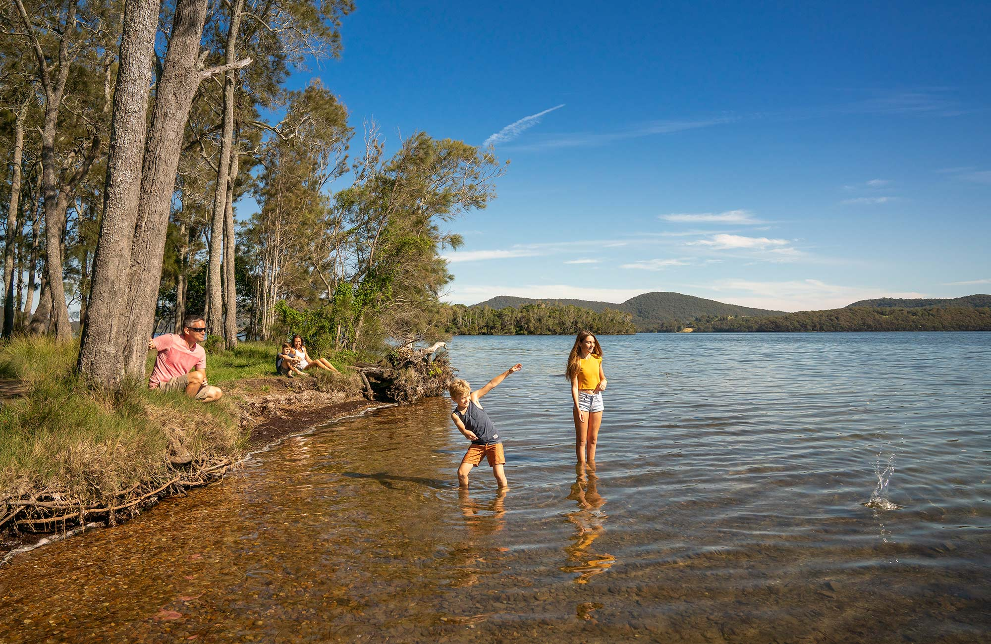 A family on the shores of Wallis Lake in Booti Booti National Park. Photo credit: John Spencer © DPIE