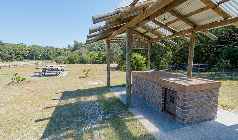 Shelter over barbecue facilities, Elizabeth Beach picnic area, Booti Booti National Park. Photo credit: John Spencer © DPIE