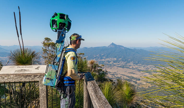 A man carrying Google Trekker equipment at Pinnacle lookout in Border Ranges National Park. Photo credit: John Spencer © DPIE
