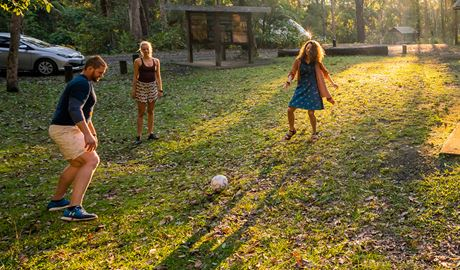 Group of friends play soccer at Sheepstation Creek campground in World Heritage-listed rainforest. Photo: DPIE/ John Spencer