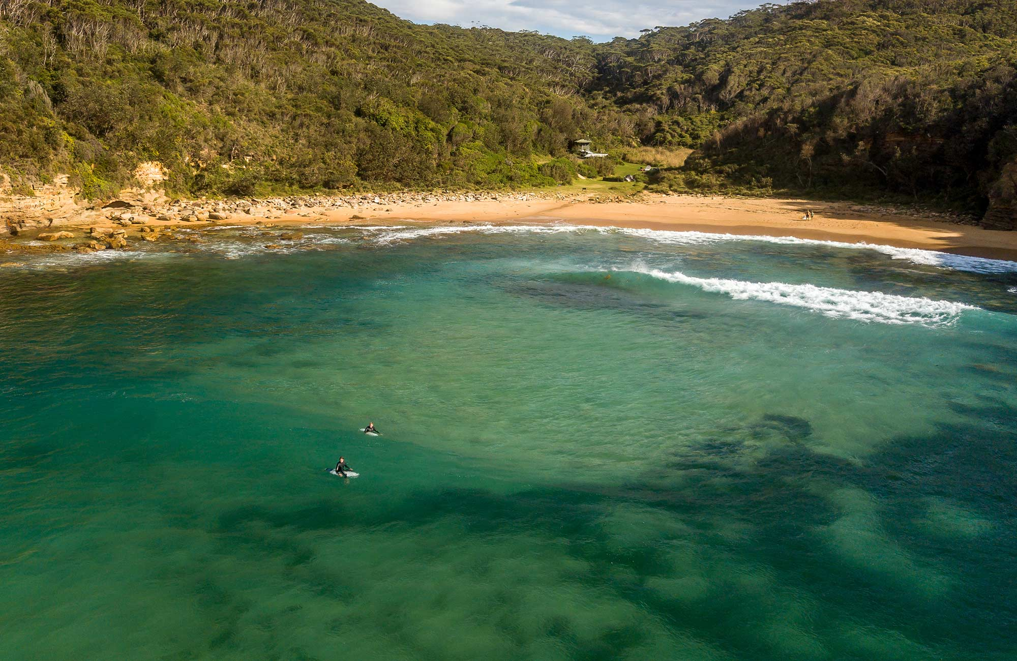 Surfers at Little Beach in Bouddi  National Park. Photo: John Spencer/DPIE