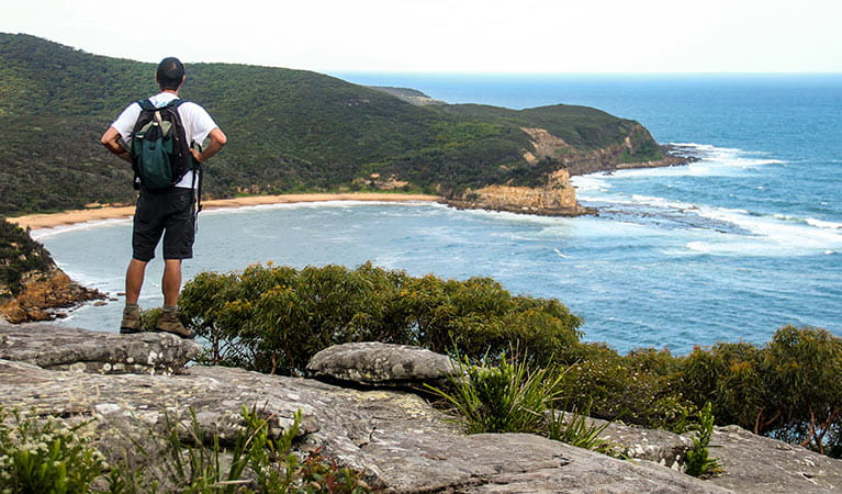 A person enjoying the view out to sea from the spur. Photo:John Yurasek