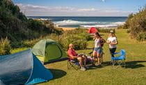 People nearby tents located at Little Beach campground, Bouddi National Park. Photo: John Spencer/DPIE.