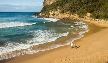 Aerial view of 2 people walking along Little Beach, Bouddi National Park. Photo: John Spencer/DPIE.