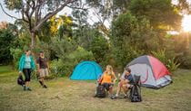 Group of friends camping at Putty Beach campground. Photo: John Spencer/DPIE